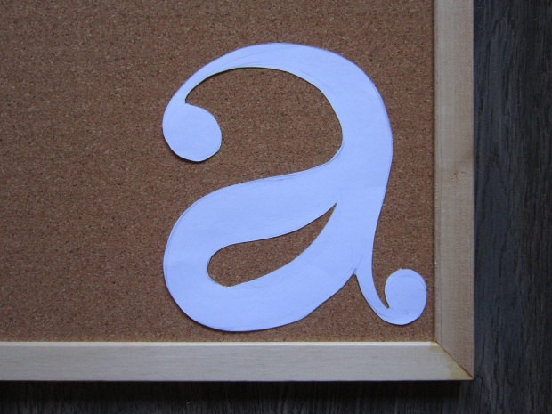 Step 2: Position stencil onto cork board using Blue Tack