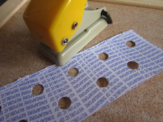 Step 6: Make a polka dot stencil using a single hole punch. It helps to mark out the positions with a pencil before punching.