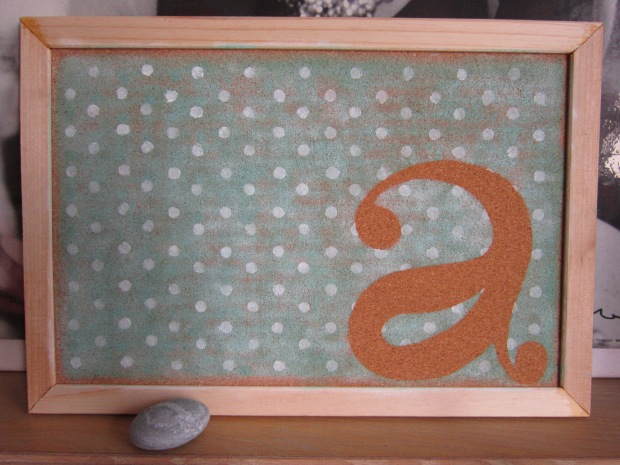 Painted polka dot cork board with initials